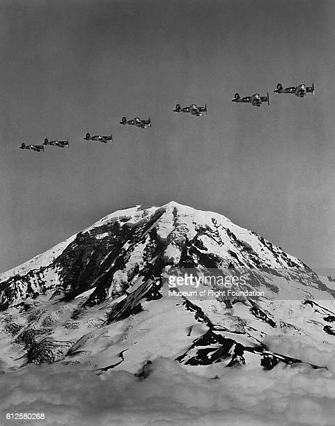 On a U S Navy training mission in 1956 a squadron of Vought F4U4 Corsair fighters from NAS Oakland fly over Mt Rainier in Washington state