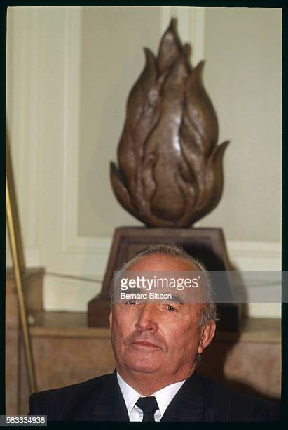 On a visit to France former Nazi SS officer and leader of the German farright wing political party Republikaners Franz Schonhuber sits beneath a...