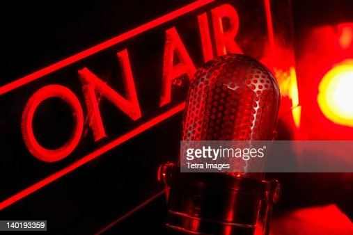 On air radio sign with microphone, studio shot
