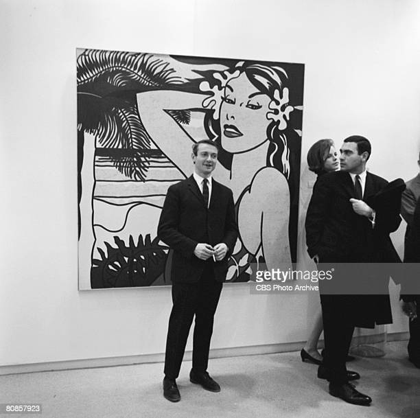 On an episode of the television documentary news program 'Eye on New York' American artist Roy Lichtenstein poses in front of an unidentified...
