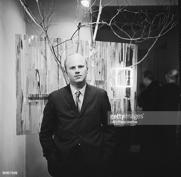 On an episode of the television documentary news program 'Eye on New York' American artist James Rosenquist poses before an unidentified painting at...