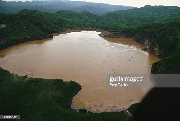 On August 21 volcanic activity under Lake Nyos produced a cloud of carbon dioxide that asphyxiated 1746 villagers