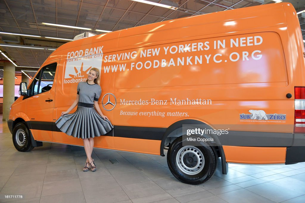 On behalf of the Food Bank For New York City, Jessica Hart accepts a $50,000 donation and a new refrigerated Sprinter van from Mercedes-Benz Manhattan. Blair Creed, General Manager of Mercedes-Benz Manhattan presents the check and Sprinter to Jessica Hart on 2/14/013.