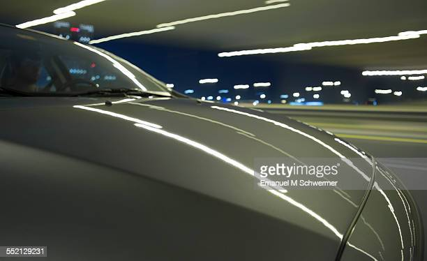 on board a car / driving nights in a city