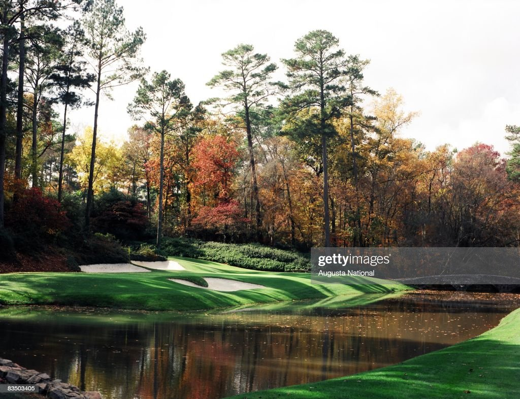 On course view of the 12th green with the Byron Nelson Bridge in the background in the Fall season at the Augusta National Golf Club in Augusta, Georgia.