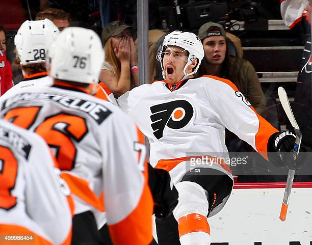 on DeMatt Read of the Philadelphia Flyers celebrates his game winning goal with teammates off the bench during the overtime period against the New...