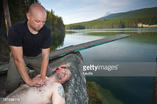 Cpr On Drowning Victim Beside Mountain Lake Stock Photo ...