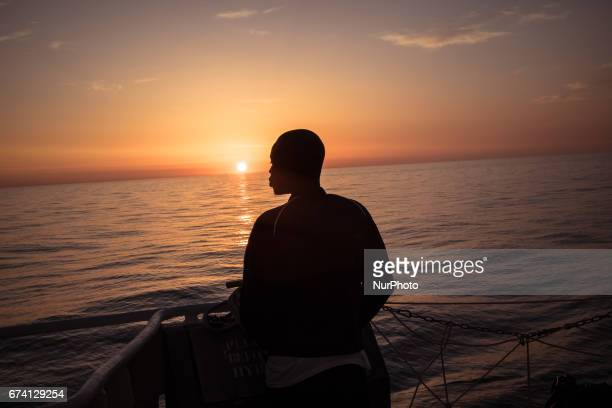 On February 23rd 2017 at sunrise a young migrant rescued from a rubber boat in distress observes the sea from the Aquarius Pushed by numerous...