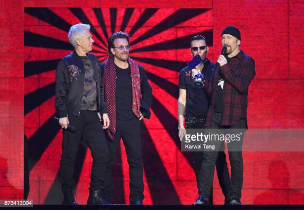 on Global Icon award winners Adam Clayton Larry Mullen Jr Bono and The Edge of U2 are seen on stage during the MTV EMAs 2017 held at The SSE Arena...