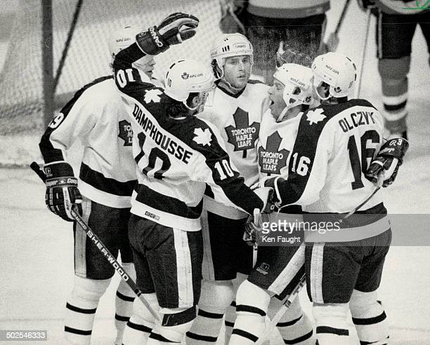 On happy day Dale DeGray seems to be having the most fun as this Leaf fivesome celebrates Toronto's first goal just 242 into game against Caps last...