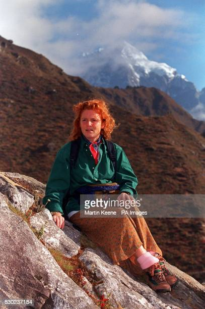 On her 34th Birthday the Duchess of York pauses beside a Nepalese prayer flag as she leaves Namche Bazaar in the Himalayas with a group of Disabled...