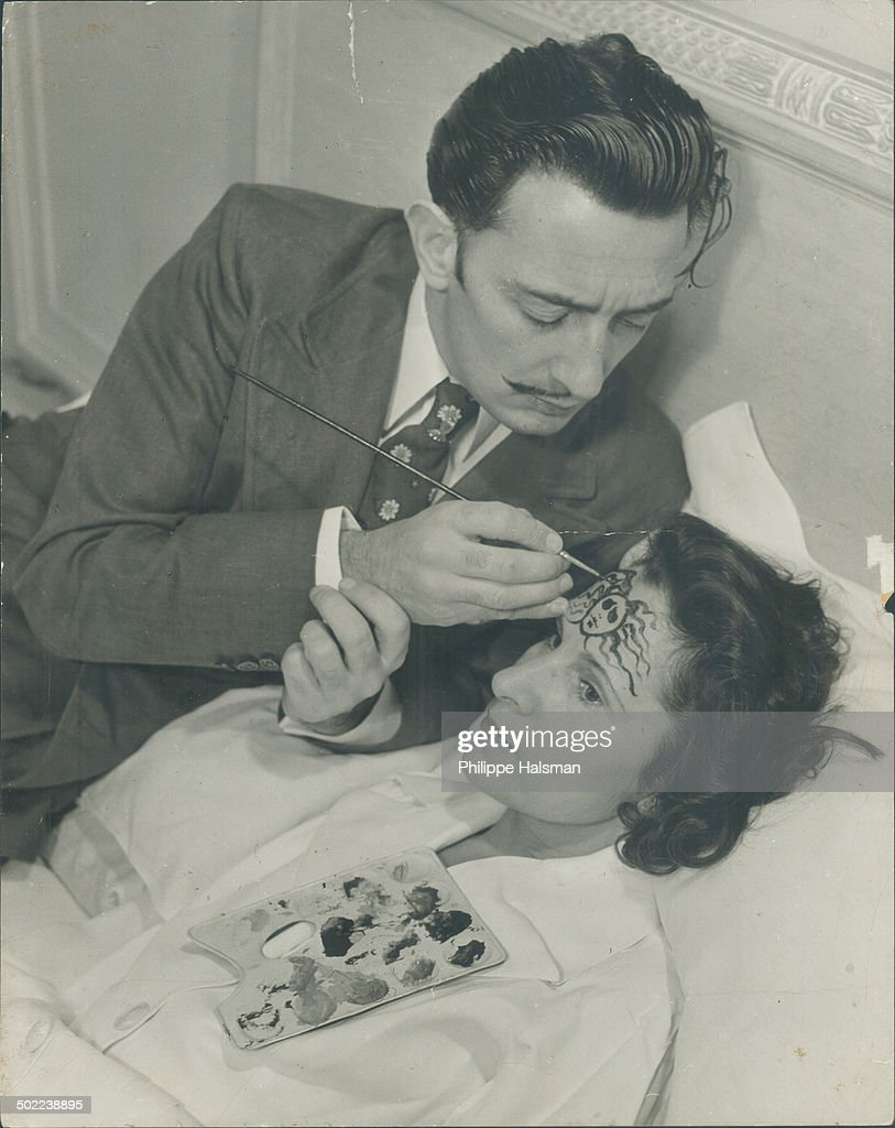 On his wife's forehead Salvador Dali paints the head of Medusa one of the three snakyhaired Gorgon sisters who glance turned into stone everything on...