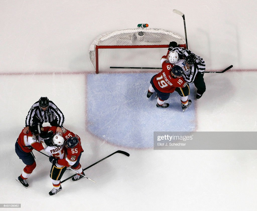NHL On Ice Official work to separate two groups fighting between the Calgary Flames and the Florida Panthers at the BB&T Center on February 24, 2017 in Sunrise, Florida.