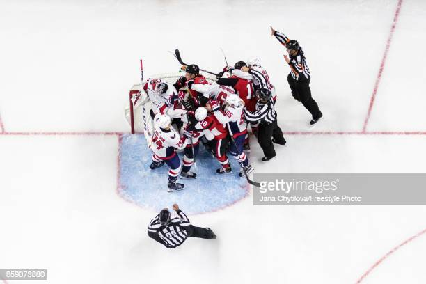 On ice officials attempt to separate members of the Ottawa Senators and members of the Washington Capitals after a whistle in the crease of Braden...