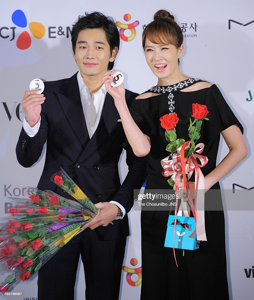 On Joo-Wan and <a gi-track='captionPersonalityLinkClicked' href=/galleries/search?phrase=Kim+Sun-A&family=editorial&specificpeople=4360741 ng-click='$event.stopPropagation()'>Kim Sun-A</a> arrive for APAN Star Road during the 18th Busan International Film Festival (BIFF) at the Haeundae Beach BIFF Village on October 4, 2013 in Busan, South Korea.