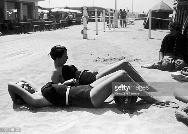 On July 29 1935 in Deauville women sunbathing on the beach accompanied by a Dachshund