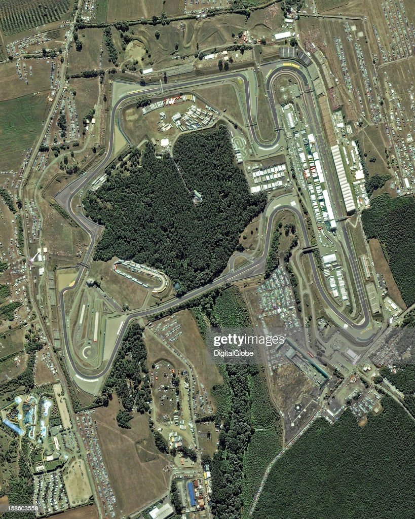 On July 29, 2012, Formula 1 drivers raced in the Hungarian Grand Prix at the Hungaroring, shown in this image taken the morning before the race. The image reveals crowds gathering in the stands and vehicles around the track as crews prepare the course for the event.