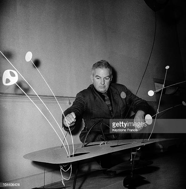 On November 4 American sculptor Alexander CALDER exhibiting his mobile sculptures in Paris at the Louis CARRE Galery setting one of his mobile...