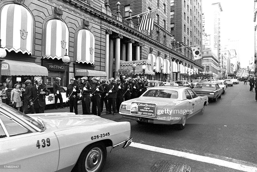 On Powell Street police officers and Tactical Squad members await President Nixon's arrival at the St Francis Hotel San Francisco California August...