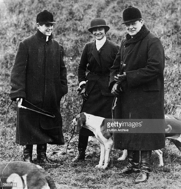 On right Winston Churchill accompanied by his son Randolph and Coco Chanel at a meet of the Duke of Westminster's boar hounds the 'Mimizan Hunt' near...