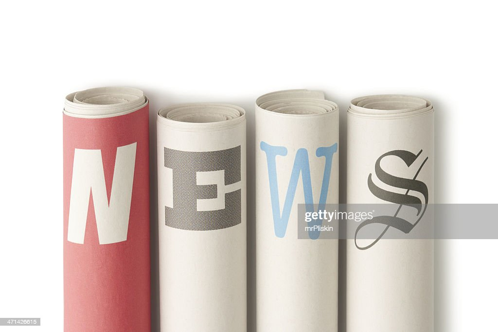 NEWS on rolled up newspapers : Stock Photo