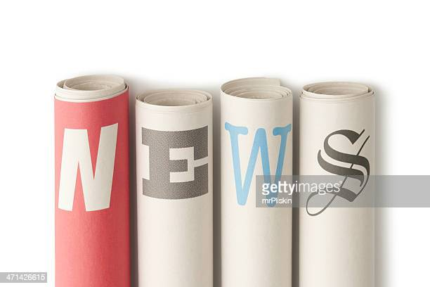 NEWS on rolled up newspapers