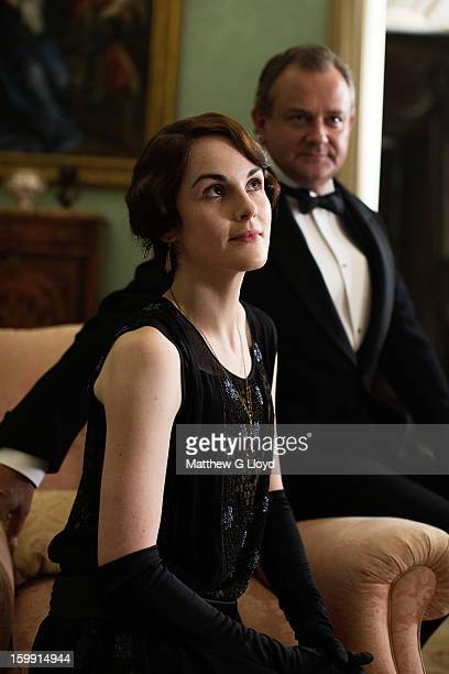On set of Downton Abbey during production of series III with actors Michelle Dockery and Hugh Bonneville photographed for the Los Angeles Times on...