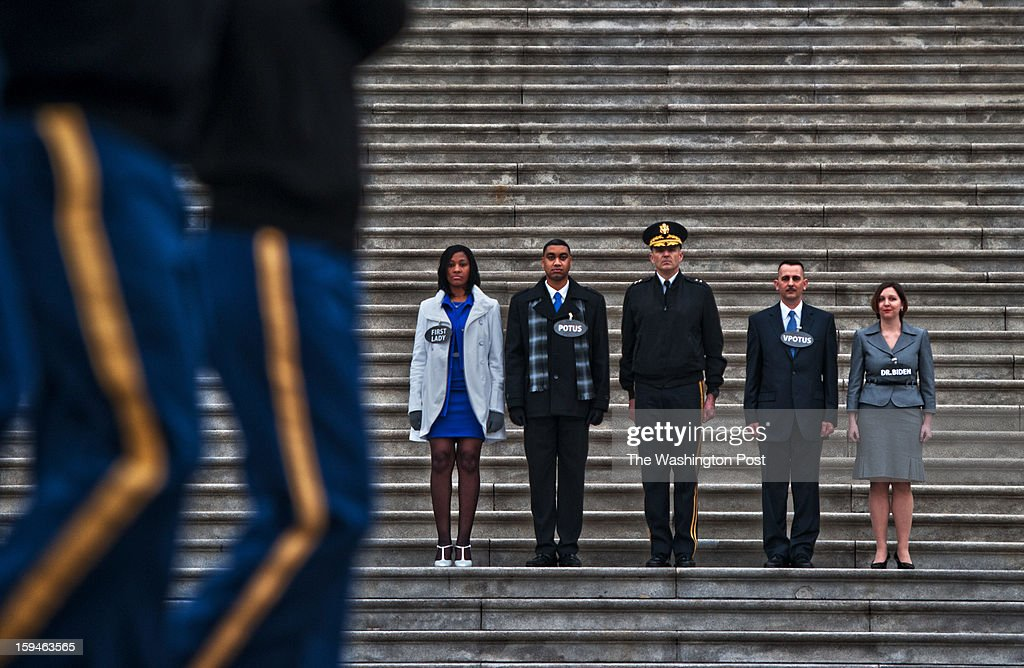 On steps of the U.S. Capitol during the dress rehearsal for the Presidential Inauguration, Delandra Rollins (L) as Mrs. Obama, Serpico D. Elliott as President Obama, Major General Michael S. Linnington (Commander For Joint Force HQ National Capital Region, U.S. Army Military District of Washington, Richard J. Bolin as Vice President Biden and Rachel M. Washko (R) as the 2nd Lady on Sunday, January 13, 2013.