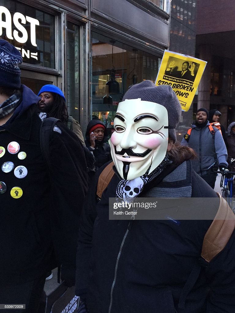 On the actual birthdate of Rev. Martin Luther King, Jr., near the Financial District of Manhattan, NYC, a Protestor Wears a '<a gi-track='captionPersonalityLinkClicked' href=/galleries/search?phrase=Guy+Fawkes&family=editorial&specificpeople=101029 ng-click='$event.stopPropagation()'>Guy Fawkes</a>' Mask as part of a March and Rally against Police Brutality & 'Broken Windows' tactics -Jan. 15, 2015.