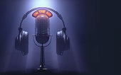 Headset on the microphone with the 'On The Air' light on.