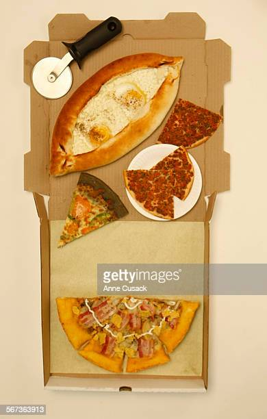 On the bottom is potato gold with sweet potato crust from Mr Pizza Factory TOP clokwise from top khachapuri an Armenian cheese pizza with eggs from...