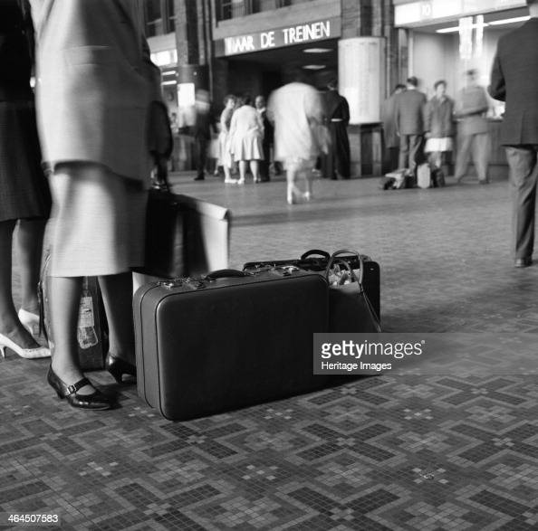 On the concourse of Centraal Station Amsterdam Netherlands 1963 A photograph for Dermide Ltd who produced materials for suitcases and travel goods at...