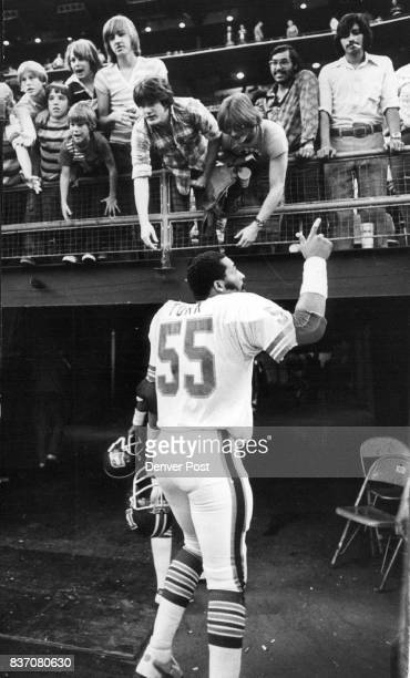 """On the Cover Godwin Turk signifies """"we're No 1"""" as he leaves field in Astrodome for dressing room while John Schultz tosses arm pad to crowd of young..."""