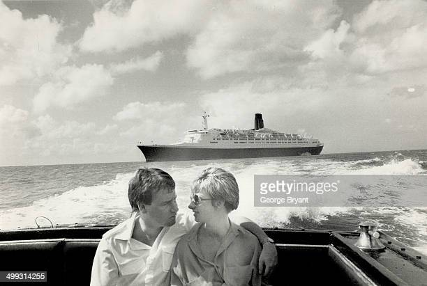 On the cruise of a lifetime a young couple leave the QE2 riding the swells behind them as they head for a day in martinique