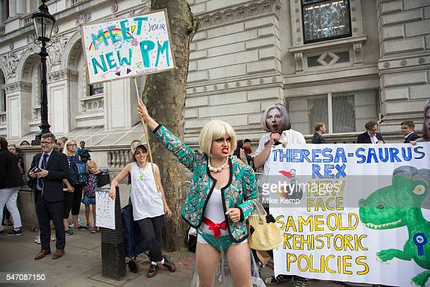 On the day that the new Conservative Party leader Theresa May MP became Prime Minister of the UK protesters humorously dressed up in face masks and...
