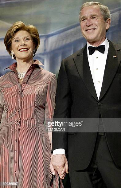 On the eve of his second inauguration US President George W Bush and First Lady Laura stand before attendees during the Black Tie Boots Ball 19...