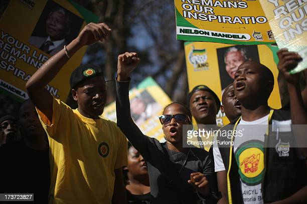 On the eve of Nelson Mandela's 95th birthday members of the ANC youth league sing and dance in his honour outside the MediClinic Heart Hospital on...