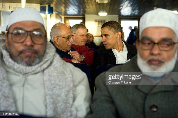 On the ferry ride to Robben Island South Africa US Sen Barack Obama converses with Ahmed Kathrada Sunday August 20 2006
