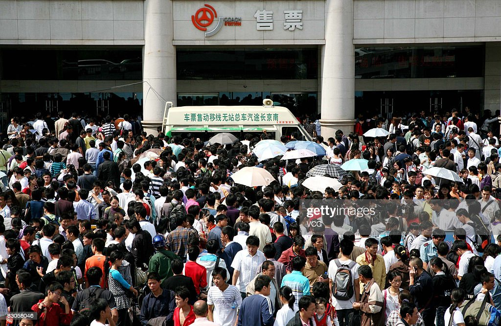 On the first day of 'Golden Week', crowds of passengers wait to get into Nanjing bus station on September 29, 2008 in Nanjing, China 'Golden Week' is a national holiday that traditionally takes place from September 29th to October 5th.