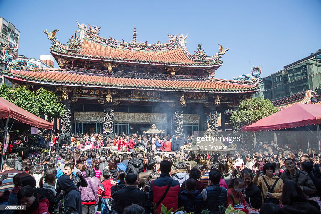 On the first day of the Chinese lunar year it is traditional to visit temples to light incense and pray for a prosperous year. Thousands come to Longshan Temple, one of the oldest and most important in Taipei every year.