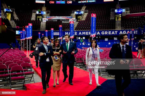 On the floor of the Quicken Arena before the Republican National Convention American broadcast journalist Hallie Jackson of NBCTV walks with...