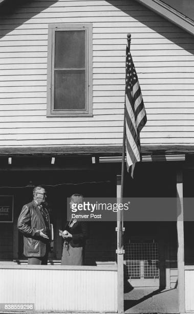 On the Front porch of Democratic headquarters in Delta Nancy Dick talks with Mayor LT Magnum of Delta Credit The Denver Post