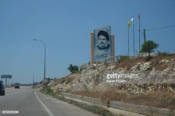 On the highway leading to stronghold territories of Hezbollah the Lebanese Shi'a Islamist militant group a picture of Sayyed Hassan Nasrallah the...