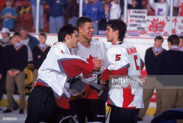 On the ice Canadian hockey players Jose Theodore Jerome Ignila and Nolan Baumgartner celebrate Team Canada's victory at the 1996 World Junior Ice...