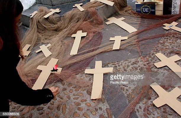 On the international day of Europe citizens have staged a performance in front of the Town Hall of Gij��n with crosses symbolizing the refugees who...