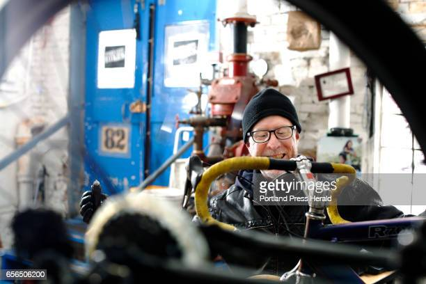 Peter Wool PORTLAND ME MARCH 15 On the Job Peter Wood owner/mechanic at Port City Bikes smiles while preparing to add new gear shifters to a 10speed...