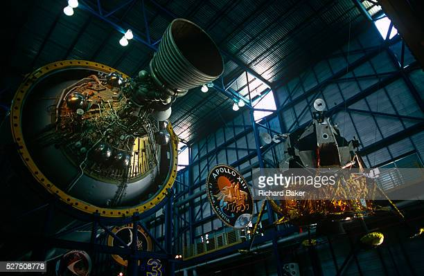 On the Kennedy Space Center visitor tour are suspended above the heads of space tourists are an Apollo rocket stage for the Saturn V rocket and a...