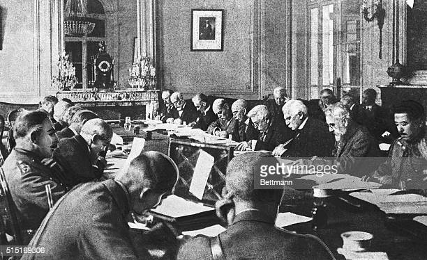 On the left side of the table from left to right General di Robilant unidentified man Italian Minister of Foreign Affairs Baron Giorgio Sonnino...