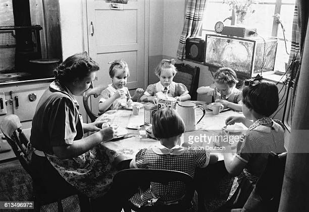 On the morning of a typical school day Mrs Good sits down to breakfast with her daughters The family includes 7yearold Susan and her four 5yearold...