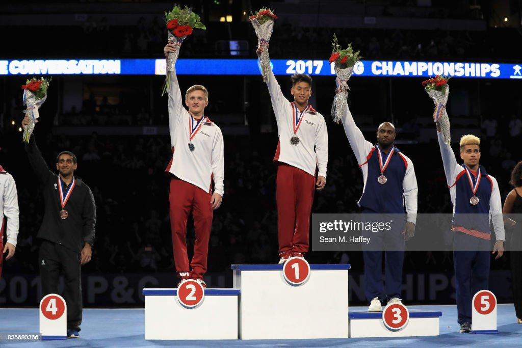 On the podium for the Men's All-Around Finals, in fourth place Akash Modi, second place Allan Bower, first place Yul Moldauer, third place Donnell Whittenburg and in fifth place Donothan Bailey stand on the podium during the P&G Gymnastic Championships at Honda Center on August 19, 2017 in Anaheim, California.